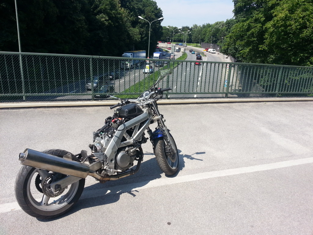 Stripped SV650 on bridge